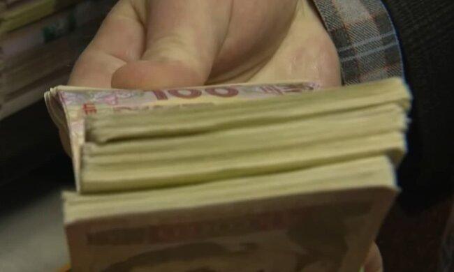 Деньги. Фото: скриншот Youtube-видео