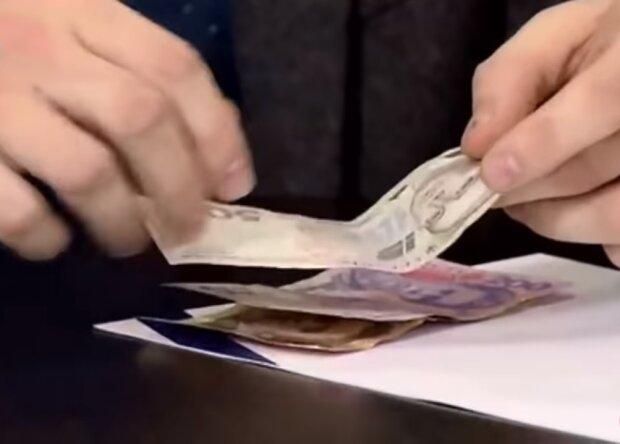 Деньги. Фото: Youtube